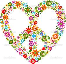 This is an image of a heart with a peace sign in the center, all made of colorful flowers.