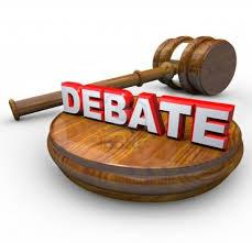 A wooden block and judge's gavel with the command DEBATE