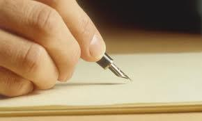A close up photo of someone's hand about to write with fountain pen and paper