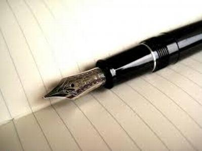 This is a photo of an open journal with a blank page and waiting fountain pen.